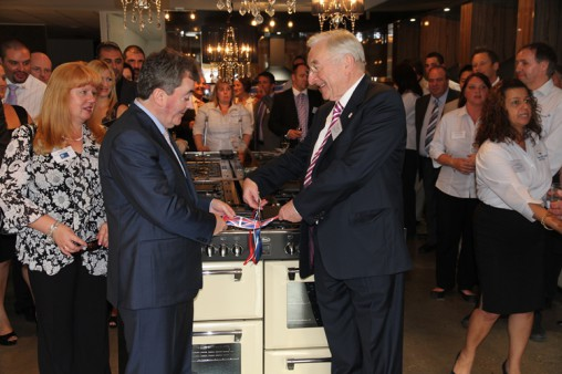 O'Driscoll (left) and Naughton cut the ribbon to open the new showroom.