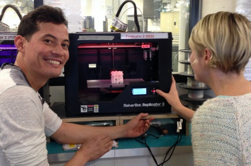 Sam Choy demonstrates the Makerbot in action